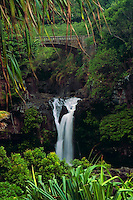 Ribbon of water flowing into a pool below the bridge at the seven pools in O'heo Gulch in HALEAKALA NATIONAL PARK  on Maui in Hawai USAi