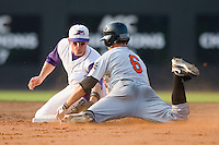 Tyler Kuhn #4 of the Winston-Salem Dash puts the tag on Matt Angle #6 of the Frederick Keys as he slides into second base at Wake Forest Baseball Stadium August 9, 2009 in Winston-Salem, North Carolina. (Photo by Brian Westerholt / Four Seam Images)