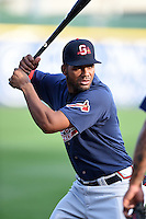 Gwinnett Braves third baseman Edward Salcedo (5) warms up before a game against the Buffalo Bisons on May 13, 2014 at Coca-Cola Field in Buffalo, New  York.  Gwinnett defeated Buffalo 3-2.  (Mike Janes/Four Seam Images)