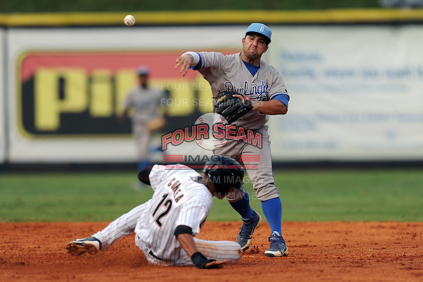 Burlington Royals second baseman Adrian Morales #3 throws over a hard sliding Carlos Correa to turn a double play during  a game against the Greenville Astros at Pioneer Park on August 17, 2012 in Greenville, Tennessee. The Astros defeated the Royals 5-1. (Tony Farlow/Four Seam Images).