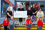 Holy Cross Mercy NS presented Unicef Ireland a cheque of €48676 at the school on Friday morning front row l-r: Kyla Wright, Levi Stack, Elena Vigros, Amelia Burke, Back l-r: Kate Donnellan, Sean O'Riordan, Deseree Crowley, Triona Sheehym Denise Lucey and Ursulla Coffey Principal