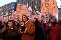 March 19th, 2002, Montreal, Quebec, Canada; <br /> <br /> Employees of TVA (Television and magazines) and of Videotron (Cable and Internet) protest in front of <br /> Quebecor headquarter in Old-Montreal.<br /> <br /> Both companies where bought recently by Quebecor with help from the Caisse de Dépôt et Placement du Québec.<br /> <br /> <br /> <br /> <br /> <br /> <br /> (Mandatory Credit: Photo by Sevy - Images Distribution (©) Copyright 2002 by Sevy<br /> <br /> NOTE :  D-1 H original JPEG, saved as Adobe 1998 RGB