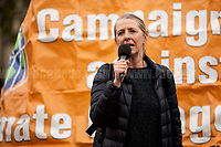 """Suzanne Jeffery (Chair of Campaign Against Climate Change and chair of the CCC Trade Union Group, CACCTU).<br /> <br /> London, 29/04/2017. Today, """"Campaign Against Climate Change"""" held a demonstration started at Old Palace Yard and ended on Westminster Bridge, where people formed a human chain showing the message: """"Trump & May Climate Disaster"""". The demonstration was in support and solidarity with the People's Climate March in the US (and over 350 other marches taking place across the globe) and to warn the British Prime Minister Theresa May to stop following Donald Trump """"down the path to climate disaster"""".<br />   <br /> For more information please click here: https://www.facebook.com/events/747422225425039/ & (Video) https://www.facebook.com/campaigncc/videos/1300562783385237/ & (Press Release) http://www.campaigncc.org/node/1782"""