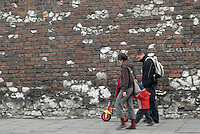 Poland, Krakow, Family walking along street, Kazimierz