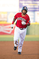 Rock Shoulders (17) of the Hickory Crawdads rounds the bases after hitting a home run against the Savannah Sand Gnats at L.P. Frans Stadium on June 15, 2015 in Hickory, North Carolina.  The Crawdads defeated the Sand Gnats 4-1.  (Brian Westerholt/Four Seam Images)