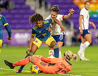 ORLANDO, FL - JANUARY 18: Jorelyn Carabalí #16 of Colombia defends Carli Lloyd #10 of the USWNT as Sandra Sepulveda #12 mishandles the ball during a game between Colombia and USWNT at Exploria Stadium on January 18, 2021 in Orlando, Florida.