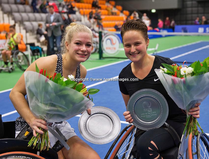 Rotterdam, Netherlands, December 19, 2015,  Topsport Centrum, Lotto NK Tennis, Wheelchair womans final: Winners Dide de Groot (L) and Aniek van Koot (NED) with the trophy<br /> Photo: Tennisimages/Henk Koster