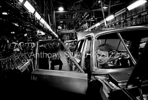 Nizhniy Novgorod, Russia  .October 1997.GAZ factory workers still produce the Volga. This car sells in Russia for about $9,000. Workers bang the windows and doors into place with hammers. The car sells very well at $9,000 but it is poorly constructed...