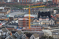 A crane working on a new building on the Kingsway with the marina in the background, Swansea, Wales, UK. Wednesday 30 January 2019