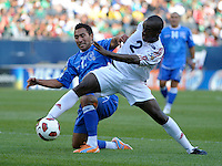 Cuba's Carlos Domingo Francisco reaches for the ball while being pressured by El Salvador's Arturo Alvarez.  El Salvador defeated Cuba 6-1 at the 2011 CONCACAF Gold Cup at Soldier Field in Chicago, IL on June 12, 2011.