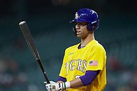 CJ Willis (23) of the LSU Tigers checks his bat during the game against the Oklahoma Sooners in game seven of the 2020 Shriners Hospitals for Children College Classic at Minute Maid Park on March 1, 2020 in Houston, Texas. The Sooners defeated the Tigers 1-0. (Brian Westerholt/Four Seam Images)