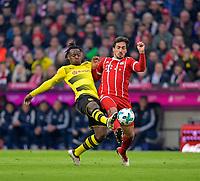 31.03.2018, Football 1. Bundesliga 2017/2018, 28.  match day, FC Bayern Muenchen - Borussia Dortmund, in Allianz-Arena Muenchen. v.li:  Michy Batshuayi (Dortmund)  -  Mats Hummels (Bayern Muenchen). *** Local Caption *** © pixathlon<br /> <br /> Contact: +49-40-22 63 02 60 , info@pixathlon.de
