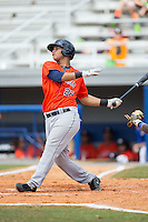 Randy Cesar (22) of the Greeneville Astros follows through on his swing against the Kingsport Mets at Hunter Wright Stadium on July 7, 2015 in Kingsport, Tennessee.  The Mets defeated the Astros 6-4. (Brian Westerholt/Four Seam Images)