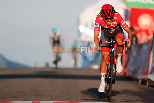 Race leader Red Jersey Richard Carapaz (ECU) Ineos Grenadiers crosses the finish line in 3rd place at the end of Stage 8 of the Vuelta Espana 2020 running 160km from Logroño to Alto de Moncalvillo, Spain. 28th October 2020.   <br /> Picture: Luis Angel Gomez/PhotoSportGomez | Cyclefile<br /> <br /> All photos usage must carry mandatory copyright credit (© Cyclefile | Luis Angel Gomez/PhotoSportGomez)