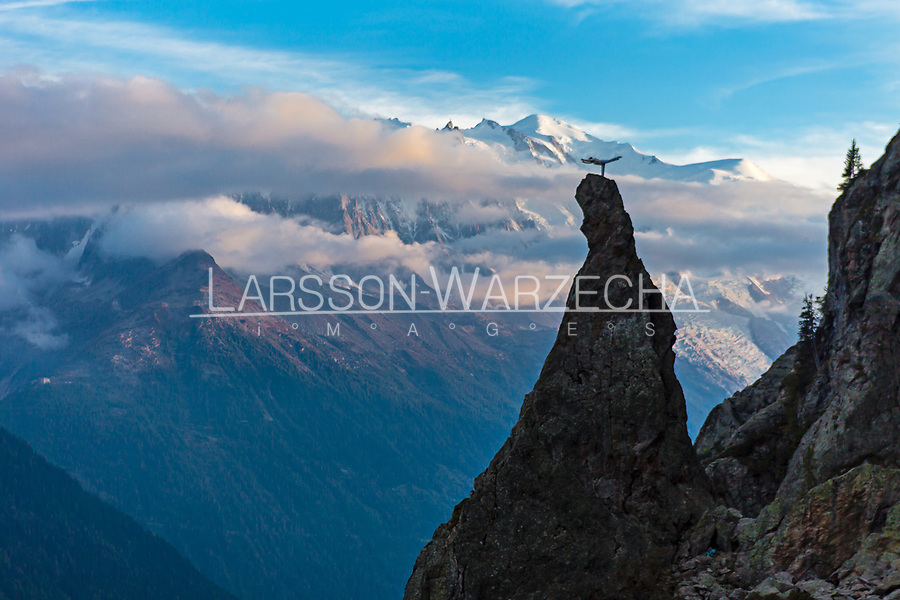 Martina Cufar practising yoga on top of the Aiguillette d'Argentiere with the Mont Blanc Massif in the background.