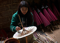 Small traditional arts and craft workshop producing traditional Umbrellas with natural and locally produced rice paper. Pindaya area, Shan State, Myanmar