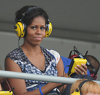 HOMESTEAD, FL - NOVEMBER 20: First lady Michelle Obama listens to a scanner of the race at the NASCAR Sprint Cup Series Ford 400 at Homestead-Miami Speedway on November 20, 2011 in Homestead, Florida<br /> <br /> <br /> People:  First Lady Michelle Obama