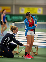 March 14, 2015, Netherlands, Rotterdam, TC Victoria, NOJK,  Roos van Reek is injured and is treated by fysiotherapist  Annelies Geel <br /> Photo: Tennisimages/Henk Koster