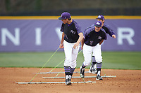 Trevor Holloway (4) and Garrett Letchworth (7) of the High Point Panthers help drag the infield between innings of the game against the North Carolina Central Eagles at Williard Stadium on February 28, 2017 in High Point, North Carolina. The Eagles defeated the Panthers 11-5. (Brian Westerholt/Four Seam Images)