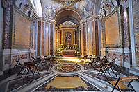 """Rome Colle Aventino, Basilica of Santa Sabina ,chapel, dedicated to Saint Catherine of Siena, also known as Cappella d'Elci, designed in 1671 by Giovanni Battista Contini,frescoes by Giovanni Odazzi.<br /> <br /> The basilica of Santa Sabina all'Aventino is a Catholic place of worship in the historic center of Rome, located on the Aventine hill, in the territory of Rione XII Ripa. Built in the 5th century on the tomb of Santa Sabina, as well as one of the best preserved early Christian churches ever,<br /> <br /> The Basilica of Saint Sabina (Latin: Basilica Sanctae Sabinae, Italian: Basilica di Santa Sabina all'Aventino) is a historic church on the Aventine Hill in Rome, Italy. It is a titular minor basilica and mother church of the Roman Catholic Order of Preachers, better known as the Dominicans.<br /> <br /> Santa Sabina is the oldest extant Roman basilica in Rome that preserves its original colonnaded rectangular plan and architectural style. Its decorations have been restored to their original restrained design. Other basilicas, such as Santa Maria Maggiore, are often heavily and ornately decorated. Because of its simplicity, the Santa Sabina represents the crossover from a roofed Roman forum to the churches of Christendom. It is especially famous for its 5th-century carved wood doors, with a cycle of Christian scenes (18 now remaining) that is one of the earliest to survive.<br /> <br /> Santa Sabina is perched high above the Tiber to the north and the Circus Maximus to the east. It is next to the small public park of Giardino degli Aranci (""""Garden of Oranges""""), which has a scenic terrace overlooking Rome. It is a short distance from the headquarters of the Knights of Malta.<br /> History<br /> Santa Sabina was built by Peter of Illyria, a Dalmatian priest, between 422 and 432  near a temple of Juno on the Aventine Hill in Rome. The church was built on the site of early Imperial houses, one of which is said to be of Sabina, a Roman matron originally from Avez"""