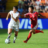 Amy Le Peilbet (l) of Team USA and Kim Su Gyong of North Korea during the FIFA Women's World Cup at the FIFA Stadium in Dresden, Germany on June 28th, 2011.