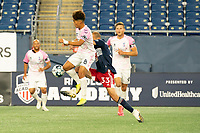 FOXBOROUGH, MA - SEPTEMBER 04: Michael Vang #8 Forward Madison FC and Tiago Mendonca #33 of New England Revolution II leap to take a high pass in the midfield during a game between Forward Madison FC and New England Revolution II at Gillette Stadium on September 04, 2020 in Foxborough, Massachusetts.