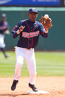 Cedar Rapids Kernels second baseman Candido Pimentel #16 turns a double play during a game against the Lansing Lugnuts at Veterans Memorial Stadium on April 30, 2013 in Cedar Rapids, Iowa. (Brace Hemmelgarn/Four Seam Images)