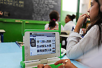 URUGUAY Montevideo, OLPC One Laptop per Child project, the 100 Dollar laptop initiative of Nicholas Negroponte, is implemented in Uruguay for children at all schools under Plan Ceibal, laptops also have access to the internet, use of facebook / URUGUAY Montevideo, fuer alle Kinder an  staatlichen Schulen Uruguays ist das OLPC one laptop per child Programm als Bildungsinitiative Plan Ceibal umgesetzt , jedes Kind bekommt einen 100 Dollar Laptop XO-1 und Zugang zum W-lan Netz der Schule