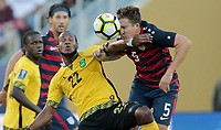 Santa Clara, CA - Wednesday July 26, 2017: Romario Williams and Matt Besler during the 2017 Gold Cup Final Championship match between the men's national teams of the United States (USA) and Jamaica (JAM) at Levi's Stadium.