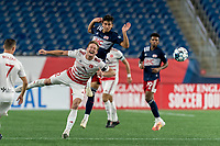 FOXBOROUGH, MA - AUGUST 21: Ian Antley #2 of Richmond Kickers and Nicolas Firmino #29 of New England Revolution II battle for head ball during a game between Richmond Kickers and New England Revolution II at Gillette Stadium on August 21, 2020 in Foxborough, Massachusetts.