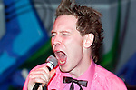 """Punk Rock Karaoke at Monkey Bar in Swansea, where members of the public can get up and sing their favorite punk songs with a live punk backing band. Dave is pictured singing """"Gordon is a moron"""" by Jilted John.."""