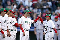 Esteban Loaiza and Paquin Estrada of Mexico during the World Baseball Championships at Angel Stadium in Anaheim,California on March 16, 2006. Photo by Larry Goren/Four Seam Images