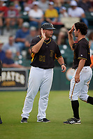 Bradenton Marauders manager Wyatt Toregas (51) high fives Daniel Amaral (43) after a Florida State League game against the Palm Beach Cardinals on May 10, 2019 at LECOM Park in Bradenton, Florida.  Bradenton defeated Palm Beach 5-1.  (Mike Janes/Four Seam Images)