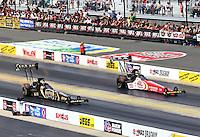 Sep 15, 2013; Charlotte, NC, USA; NHRA top fuel dragster driver Khalid Albalooshi (near lane) races alongside Doug Kalitta during the Carolina Nationals at zMax Dragway. Mandatory Credit: Mark J. Rebilas-