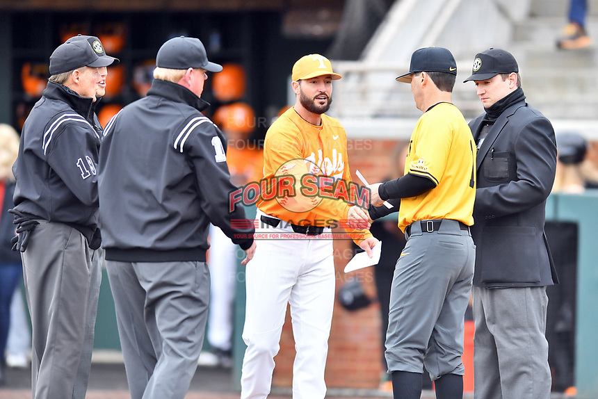 Tennessee Volunteers head coach Tony Vitello (24) shakes hands with Appalachian State head coach Kermit Smith (1) whiles umpires Jordan Ferrell, Zach Neff, Jack Cox and Darrell Arnold look on at Lindsey Nelson Stadium on February 16, 2019 in Knoxville, Tennessee. The Volunteers defeated Mountaineers 2-0. (Tony Farlow/Four Seam Images)