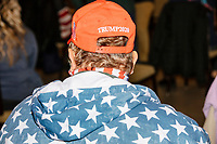 People wearing Donald Trump campaign clothing wait in the audience before Donald Trump, Jr., the son of US president Donald Trump, speaks at a 'Make America Great Again!' campaign rally at DoubleTree by Hilton MHT in Manchester, New Hampshire, on Thu., Oct. 29, 2020. The event took place five days before the Nov. 3 presidential election.