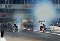 May 1, 2011; Baytown, TX, USA: NHRA top fuel dragster driver Morgan Lucas (left) races alongside Terry McMillen in the first round of the Spring Nationals at Royal Purple Raceway. Mandatory Credit: Mark J. Rebilas-