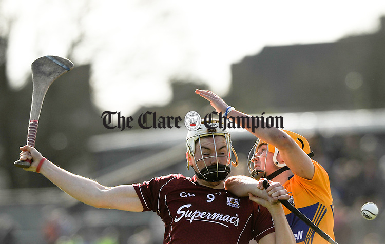 Padraig Brehony of Galway in action against Colm Galvin of Clare during their NHL Division 1 Round 5 game at Cusack park, Ennis. Photograph by John Kelly.