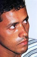 """O latrocida J˙lio CÈsar Pelado,assassino confesscodo lÌder sindical Dema Ademir Fredericc apresentado durante a conclus""""o do inquerito.<br /> 30/08/2001.<br /> Foto Paulo Santos/Interfoto<br /> <br /> Passeata em manifestaÁ""""o pelo assassinato do lÌder sindical Ademir  Federicci em Altamira no Par· (Da esq. para direita)AntÙnio JosÈ Federicci, irm""""o- Marina Feu, viuva- Catarina Feu, m‡e viuva - Cleber Fideu , filho.<br /> Foto Paula Sampaio<br /> 31/08/2001<br /> <br /> Ademir Alfeu Federicci foi baleado em sua casa na madrugada de 25/08. Acredita-se que o crime tenha motivação política, já que Dema, como era chamado, era a principal liderança em Altamira (PA) na luta contra latifundiários, madeireiros e barragens. Uma manifestação acontecerá na sexta-feira em protesto contra a violência na região.<br /> <br /> <br /> Na madrugada de 25/08, por volta de 02:30 horas, Ademir Alfeu Federicci, um dos coordenadores do Movimento pelo Desenvolvimento da Transamazônica e do Xingu (MDTX)) foi assassinado. Segundo relato da polícia civil local, sua casa foi invadida por um homem armado, com quem Dema travou luta corporal e de quem recebeu um tiro que o atingiu na cabeça. A versão oficial dá conta de que se tratou de um assalto. Mas, de acordo com Ayrton Faleiro, diretor de Política Agrária da Contag (Confederação Nacional dos Trabalhadores Agrícolas), não foi realizada perícia no local, nem exame de balística e o corpo só chegou à funerária duas horas depois de ter sido retirado da casa."""