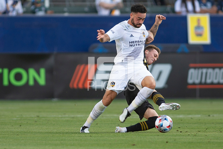 CARSON, CA - MAY 8: Derrick Williams #3 of the Los Angeles Galaxy battles with Corey Baird #13 of LAFC during a game between Los Angeles FC and Los Angeles Galaxy at Dignity Health Sports Park on May 8, 2021 in Carson, California.