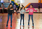 WATERBURY, CT-122717JS09----Jayda Santiago, 12, Lin Ramos, 10, and Janellys Parra, 12, skate around the rink during an anti-violence program Thursday at Roller Magic in Waterbury. The event was sponsored by Let's Go Youth United and Connecticut Against Violence of Bridgeport. More than 100 local students were selected to participate in the event. <br />  Jim Shannon Republican-American
