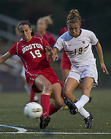 Boston College midfielder Kristen Mewis (19) takes a shot as Boston University defender Kai Miller (19) defends. After 2 complete overtime periods, Boston College tied Boston University, 1-1, after 2 overtime periods at Newton Soccer Field, August 19, 2011.