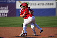 Auburn Doubledays David Kerian (21) celebrates with Diomedes Eusebio (31) after a walk off base hit during a game against the Batavia Muckdogs on September 7, 2015 at Falcon Park in Auburn, New York.  Auburn defeated Batavia 11-10 in ten innings.  (Mike Janes/Four Seam Images)
