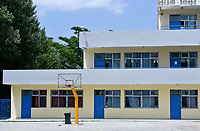 """Pictured: The yard of the 6th Primary School in Acharnes, Athens, Greece. Friday 09 June 2017<br /> Re: An 11 year old boy has been shot dead by a """"stray bullet"""" during a school celebration in Acharnes (Menidi) area, in the outskirts of Athens, Greece.<br /> Marios Dimitrios Souloukos """"complained to his mum"""" who works as a teacher at the 6th Primary School of Acharnes that he was feeling unwell, he then collapsed with blood pouring out from the top of his head.<br /> His mum tried to revive him assisted by other teachers while his schoolmates who were reportedly upset, were hurriedly removed by their parents.<br /> According to locals an ambulance arrived 25 minutes late.<br /> Hundreds of police officers have been deployed in the area and have raided many properties.<br /> Shells matching the fatal bullet which hit the boy on the top of his head were found in a house yard nearby.<br /> Local people reported hearing shots being fired at a nearby Romany Gypsy camp before the fatal incident.<br /> The area has been plagued with criminality during the last few years."""