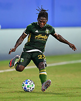 LAKE BUENA VISTA, FL - JULY 18: Yimmi Chará #23 of the Portland Timbers passes the ball during a game between Houston Dynamo and Portland Timbers at ESPN Wide World of Sports on July 18, 2020 in Lake Buena Vista, Florida.