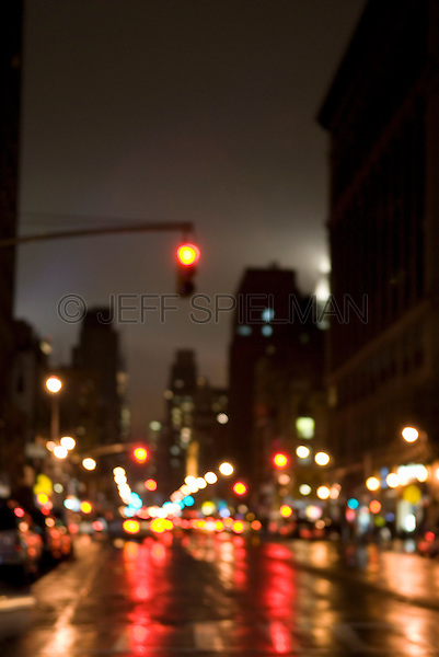 AVAILABLE FROM JEFF AS A FINE ART PRINT.<br /> <br /> AVAILABLE FOR COMMERCIAL AND EDITORIAL LICENSING FROM PLAINPICTURE.  Please go to www.plainpicture.com and search for image # p5690121.<br /> <br /> Rainy Street Scene at Night, Sixth Avenue, Lower Manhattan, New York City, New York State, USA