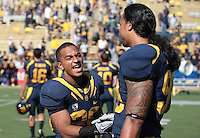 Isi Sofele celebrates with Savai'i Eselu after the game. The University of California Berkeley Golden Bears defeated the UC Davis Aggies 52-3 in their home opener at Memorial Stadium in Berkeley, California on September 4th, 2010.