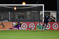 LAKE BUENA VISTA, FL - JULY 26: Alan Pulido of Sporting KC wrong-foots Thomas Hasal of Vancouver Whitecaps FC in the shootout to score during a game between Vancouver Whitecaps and Sporting Kansas City at ESPN Wide World of Sports on July 26, 2020 in Lake Buena Vista, Florida.