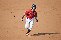 Ramon Beltre (1) of the Kannapolis Intimidators hustles towards third base against the Hickory Crawdads at Kannapolis Intimidators Stadium on June 2, 2019 in Kannapolis, North Carolina. The Intimidators defeated the Crawdads 4-3. (Brian Westerholt/Four Seam Images)