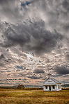 Clouds pass above the historic Salt Springs Valley one-room schoolhouse in the Sierra Nevada Foothills of the Mother Lode of Calif.